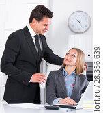 Купить «Adult business couple flirting in office», фото № 28356639, снято 20 апреля 2017 г. (c) Яков Филимонов / Фотобанк Лори