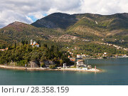 Купить «Montenegro. Boka Kotor Bay. A picturesque view on the church on the hill (Pejina Crkva)», фото № 28358159, снято 8 октября 2016 г. (c) Виктория Катьянова / Фотобанк Лори