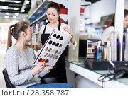 Купить «hairdresser edvise woman client about samples of hair dye», фото № 28358787, снято 31 марта 2018 г. (c) Яков Филимонов / Фотобанк Лори