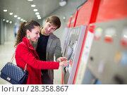 Купить «couple purchasing tickets», фото № 28358867, снято 22 октября 2019 г. (c) Яков Филимонов / Фотобанк Лори