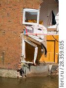 Купить «Flooded house in Tewkesbury, after heavy rainfall, Gloucestershire, England, UK, 25th July 2007.», фото № 28359035, снято 22 сентября 2018 г. (c) Nature Picture Library / Фотобанк Лори