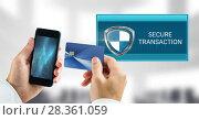 Купить «Secure transaction shield icon and phone with bank card», фото № 28361059, снято 8 июля 2020 г. (c) Wavebreak Media / Фотобанк Лори