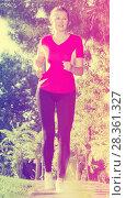 Sporty girl in pink T-shirt is running around. Стоковое фото, фотограф Яков Филимонов / Фотобанк Лори