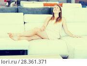 Купить «female customer relaxation and testing sofa», фото № 28361371, снято 5 сентября 2017 г. (c) Яков Филимонов / Фотобанк Лори