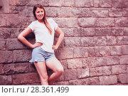 Купить «Romantic girl with stone wall background», фото № 28361499, снято 15 августа 2017 г. (c) Яков Филимонов / Фотобанк Лори