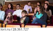 Купить «Audience eating popcorn and watching a movie», фото № 28361727, снято 3 декабря 2016 г. (c) Яков Филимонов / Фотобанк Лори
