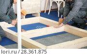 Купить «Two male workers in uniform carpenters does woodworking», видеоролик № 28361875, снято 17 июля 2018 г. (c) Константин Шишкин / Фотобанк Лори