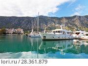 Купить «Montenegro. Quay in Kotor town with beautiful sea yachts on the clear blue water of Boka Kotor Bay», фото № 28361879, снято 8 октября 2016 г. (c) Виктория Катьянова / Фотобанк Лори