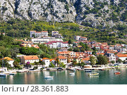 Купить «Montenegro. Kotor Bay. A picturesque view of the embankment of Dobrota town on a sunny summer day», фото № 28361883, снято 8 октября 2016 г. (c) Виктория Катьянова / Фотобанк Лори
