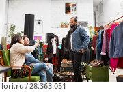 Купить «friends choosing clothes at vintage clothing store», фото № 28363051, снято 30 ноября 2017 г. (c) Syda Productions / Фотобанк Лори