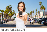 Купить «woman taking selfie by smartphone in los angeles», фото № 28363075, снято 25 июля 2013 г. (c) Syda Productions / Фотобанк Лори
