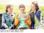 Купить «happy friends with tablet pc computer outdoors», фото № 28363191, снято 21 мая 2016 г. (c) Syda Productions / Фотобанк Лори