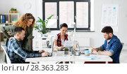 Купить «creative team working on user interface at office», фото № 28363283, снято 1 апреля 2018 г. (c) Syda Productions / Фотобанк Лори