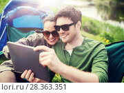 Купить «happy couple with tablet pc at camping tent», фото № 28363351, снято 27 мая 2016 г. (c) Syda Productions / Фотобанк Лори