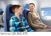 Купить «happy mother and son traveling by plane», фото № 28363375, снято 21 октября 2015 г. (c) Syda Productions / Фотобанк Лори