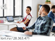 Купить «creative office workers with user interface mockup», фото № 28363471, снято 1 апреля 2018 г. (c) Syda Productions / Фотобанк Лори