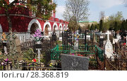 Купить «Moscow, Russia - April 30. 2018. Alekseevskoe cemetery near Temple of Tikhvin Icon of Mother God», видеоролик № 28368819, снято 1 мая 2018 г. (c) Володина Ольга / Фотобанк Лори