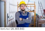 Купить «Portrait of workman which is repearing the wiring», фото № 28369843, снято 3 июня 2017 г. (c) Яков Филимонов / Фотобанк Лори