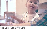 Купить «Young Woman And Little Boy During Homework», видеоролик № 28370095, снято 14 декабря 2017 г. (c) Pavel Biryukov / Фотобанк Лори