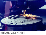 3D metal printer produces a steel part. Стоковое фото, фотограф Андрей Радченко / Фотобанк Лори