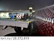 Купить «Dubai, UAE - April 10. 2018. boarding airline Rossiya at the airport», фото № 28372819, снято 10 апреля 2018 г. (c) Володина Ольга / Фотобанк Лори