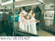 Купить «Family and kids is visiting of escape room», фото № 28372927, снято 3 августа 2017 г. (c) Яков Филимонов / Фотобанк Лори