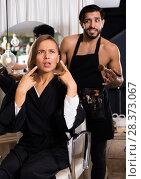 Купить «professional makeup artist with female shocked», фото № 28373067, снято 20 июня 2018 г. (c) Яков Филимонов / Фотобанк Лори