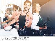Купить «Smiling woman hairdresser and male makeup artist», фото № 28373071, снято 23 сентября 2018 г. (c) Яков Филимонов / Фотобанк Лори