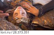 Купить «Python crawling on the face of young female dancer in bright costume», видеоролик № 28373351, снято 25 сентября 2018 г. (c) Константин Шишкин / Фотобанк Лори