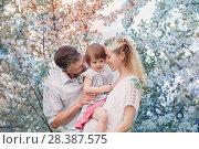Купить «happy family on spring garden», фото № 28387575, снято 5 мая 2018 г. (c) Майя Крученкова / Фотобанк Лори