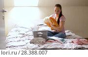 Купить «woman or housewife sorting laundry at home», видеоролик № 28388007, снято 30 апреля 2018 г. (c) Syda Productions / Фотобанк Лори