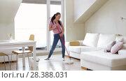 Купить «woman or housewife with mop cleaning floor at home», видеоролик № 28388031, снято 30 апреля 2018 г. (c) Syda Productions / Фотобанк Лори