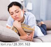 Купить «Portrait of gloomy young woman with pillow», фото № 28391163, снято 2 июня 2017 г. (c) Яков Филимонов / Фотобанк Лори