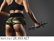 Купить «Sexy fitness buttocks close-up. Part of fitness body on a black background.», фото № 28393427, снято 8 мая 2018 г. (c) Restyler Viacheslav / Фотобанк Лори