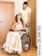 Купить «Worker brought girl in wheelchair», фото № 28394103, снято 26 мая 2018 г. (c) Яков Филимонов / Фотобанк Лори