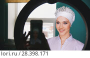 Купить «Female hands shooting on smartphone happy muslim bride with professional make up and tiara», фото № 28398171, снято 27 мая 2018 г. (c) Константин Шишкин / Фотобанк Лори