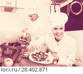 Купить «Adult happy female cook holding plate», фото № 28402871, снято 19 июля 2018 г. (c) Яков Филимонов / Фотобанк Лори