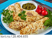 crepes with chicken meat and sauce pesto. Стоковое фото, фотограф Oksana Zh / Фотобанк Лори