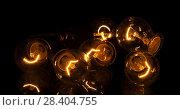 Купить «Incandescent lamps in operation, isolated on black», фото № 28404755, снято 4 февраля 2016 г. (c) Сергей Молодиков / Фотобанк Лори