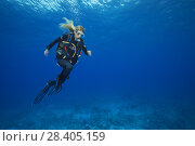 Купить «Female scuba diver run in the blue water underwater, is having fun in time safety stop in a strong current», фото № 28405159, снято 13 марта 2018 г. (c) Некрасов Андрей / Фотобанк Лори