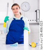 Купить «Cheerful female cleaner is ready to clean the cabinet», фото № 28406023, снято 21 мая 2017 г. (c) Яков Филимонов / Фотобанк Лори