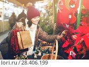 Купить «Nice teen girl chooses floral decorations», фото № 28406199, снято 12 декабря 2016 г. (c) Яков Филимонов / Фотобанк Лори