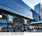 Купить «Kyoto Station, Kyoto-eki, modern glass building busy with people in the evening, second largest train station building in Japan. Shimogyo-ku, Kyoto, Japan.», фото № 28407963, снято 21 ноября 2017 г. (c) age Fotostock / Фотобанк Лори