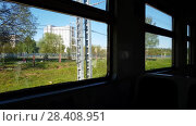 Купить «view from window of the train to suburb of Russia», видеоролик № 28408951, снято 10 мая 2018 г. (c) Володина Ольга / Фотобанк Лори