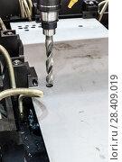 Купить «CNC Coordinate drilling machine. The drill bit is installed in the drill chuck.», фото № 28409019, снято 10 ноября 2016 г. (c) Андрей Радченко / Фотобанк Лори