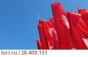Купить «many Red flags swaying in wind against the blue sky», видеоролик № 28409151, снято 15 мая 2018 г. (c) Володина Ольга / Фотобанк Лори