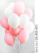 Купить «Colourful balloons, pink, white, streamers. Helium Ballon floating in birthday party. Concept balloon of love and valentine», фото № 28409451, снято 29 апреля 2018 г. (c) Сергей Тимофеев / Фотобанк Лори