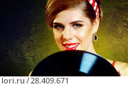 Купить «Retro woman with music vinyl record. Pin-up retro female style», фото № 28409671, снято 21 сентября 2018 г. (c) Gennadiy Poznyakov / Фотобанк Лори