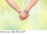 Купить «hands of couple with gay pride rainbow wristbands», фото № 28410327, снято 2 ноября 2017 г. (c) Syda Productions / Фотобанк Лори