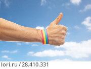 Купить «hand with gay pride rainbow wristband shows thumb», фото № 28410331, снято 2 ноября 2017 г. (c) Syda Productions / Фотобанк Лори